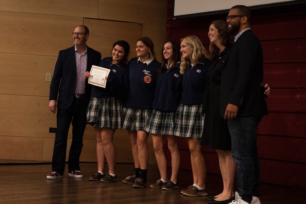 Academy of Sacred Heart accepts their award for first place in Cover Design for their 2017-18 Yearbook.